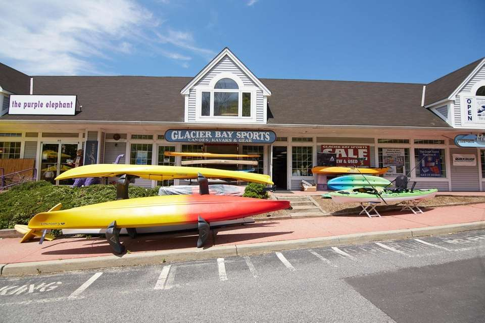 Kayaks for rent and sale are outside on