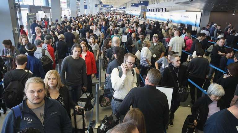 Passengers at O'Hare International Airport in Chicago wait