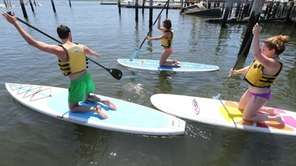 Heading out on paddle boards at Empire Kayaks