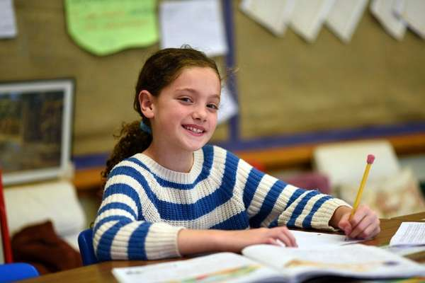 Third-grader Cecilia Saad, 9, is seen in class