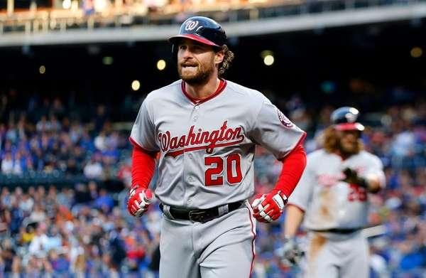 Daniel Murphy trots back to dugout after hitting