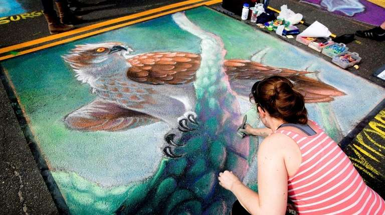 Katie Better of Glen Cove paints the street