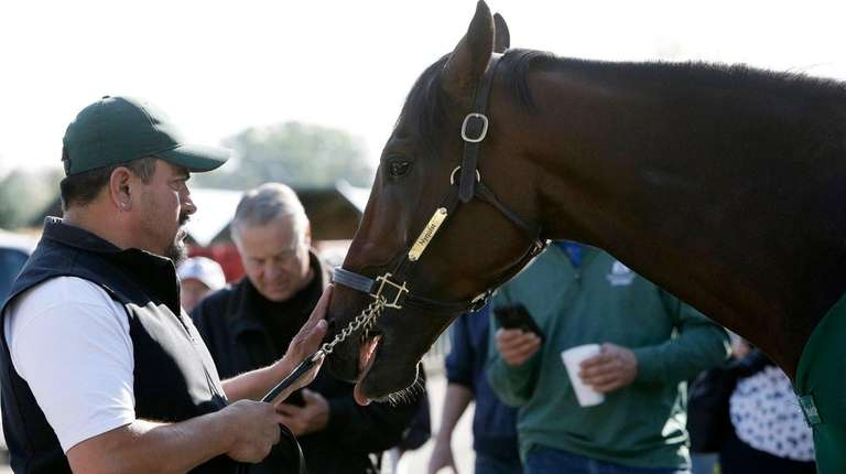 Nyquist is tended to by hot walker Lefty