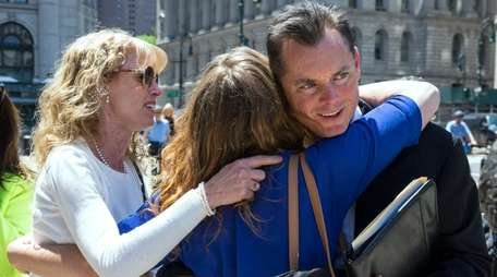 Private investigator Joseph Dwyer is hugged by a