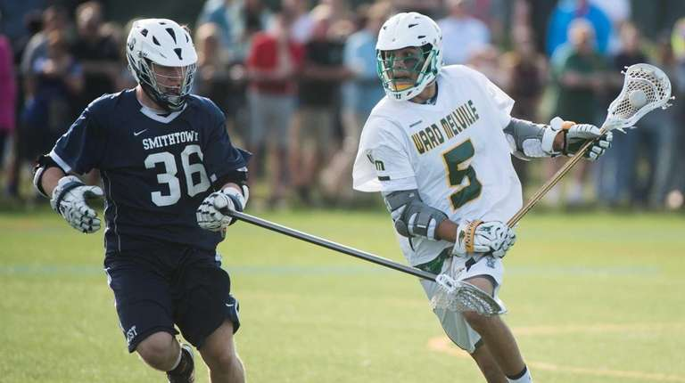 Ward Melville's Dom Pryor (5) moves the ball