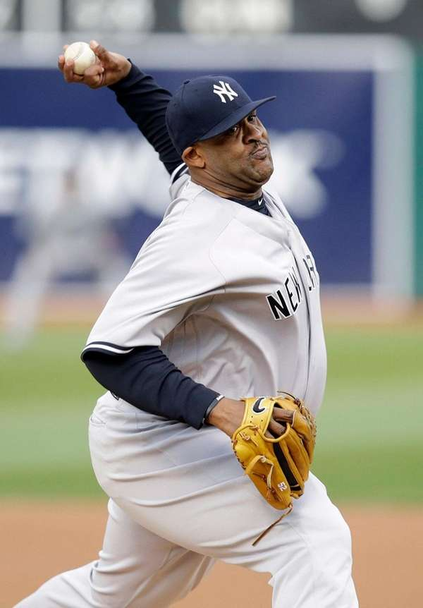 New York Yankees starting pitcher CC Sabathia throws