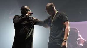 Hip-hop artist Sean Combs, left, and rapper Jay