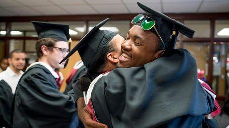 Graduates celebrate after just receiving their diplomas at