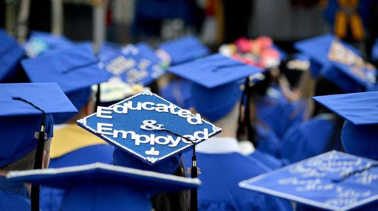 A cap stands out among the graduates attending