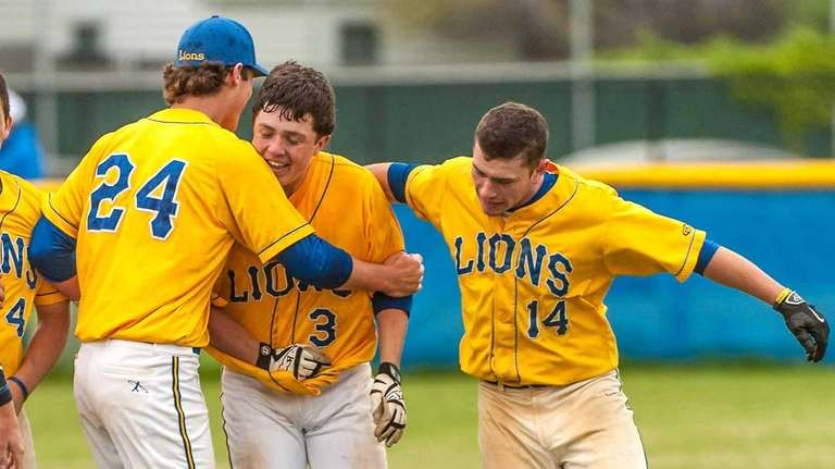 West Islip's Kyle O'Neil (3, center), who got