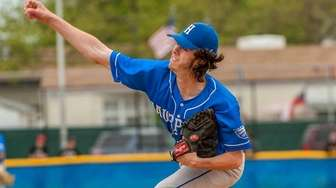 Hauppauge's Tim Woodford (12) pitching against West Islip