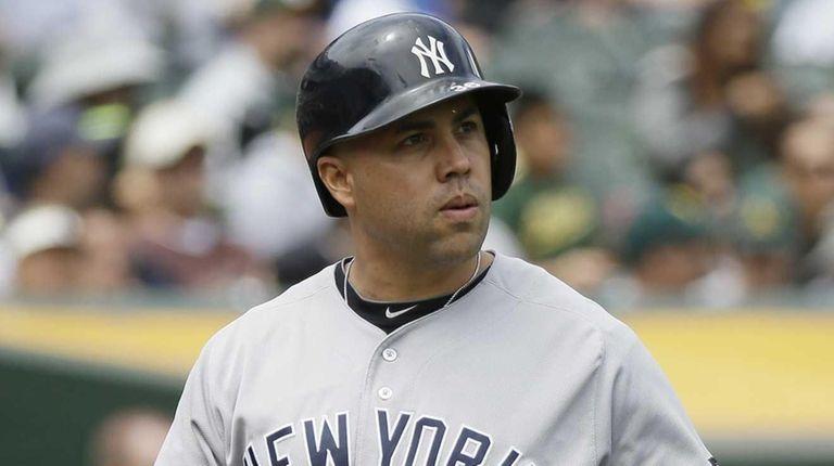 New York Yankees' Carlos Beltran walks back to