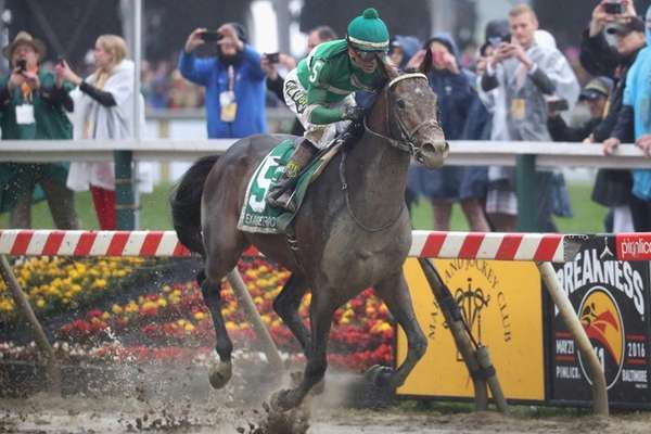 Exaggerator ridden by Kent Desormeaux leads the field