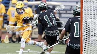 Comsewogue's John Koebel (5) bounces a low shot
