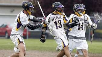Sayville's Jack Coan (17) and Ashton Bradley (14)