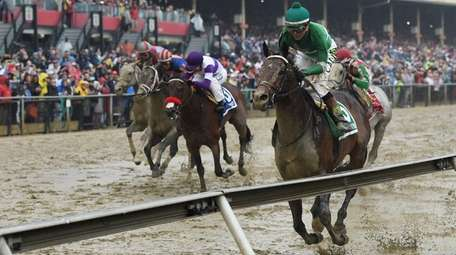Exaggerator, ridden by Kent Desormeaux, wins the the