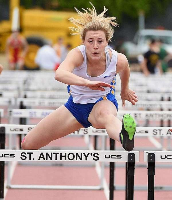 Kellenberg Gabby Schreib clears the final hurdle in