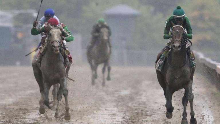 Exaggerator, right, with Kent Desormeaux aboard wins the