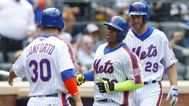 Yoenis Cespedes #52 and Michael Conforto #30 of