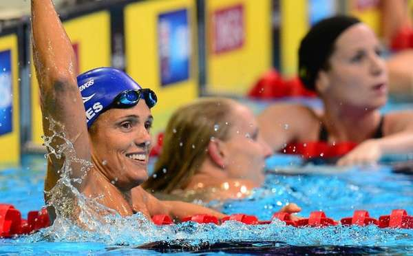 Dara Torres, 45, (L) celebrates her second place