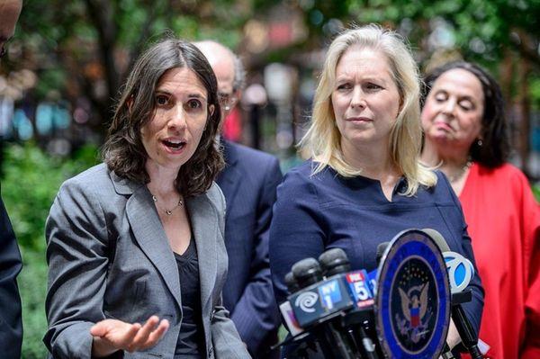 Deputy Commissioner of Health Marisa Raphael, left, speaks,