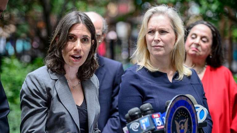 Deputy Commissioner of Health Marisa Raphael, left, speaks,