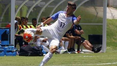 USA's Paul Arriola looks to get by Puerto
