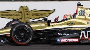 James Hinchcliffe celebrates after winning the pole for