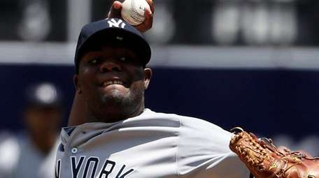 Yankees starting pitcher Michael Pineda delivers a pitch