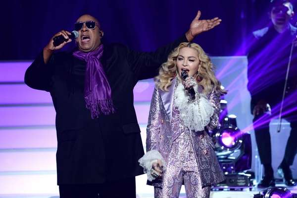 Recording artists Stevie Wonder and Madonna perform a