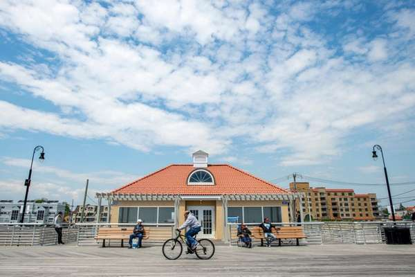 Visitors to Long Beach wander past a comfort
