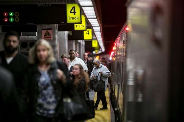 Commuters exit Long Island Rail Road at the