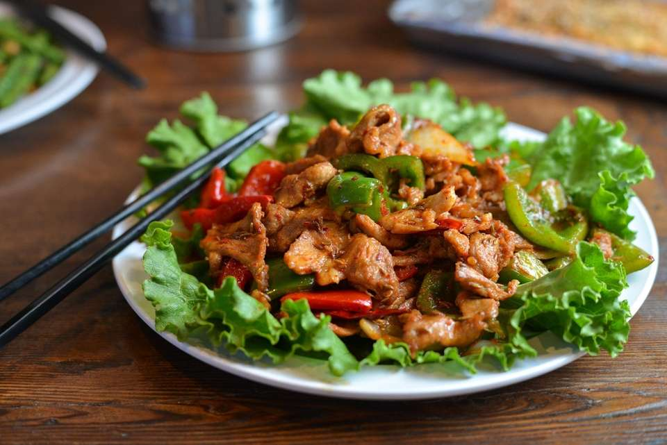 Cumin lamb with peppers is served at LOL