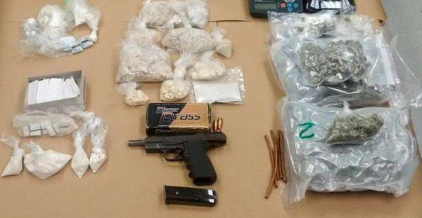 Drugs, cash and a handgun were seized after