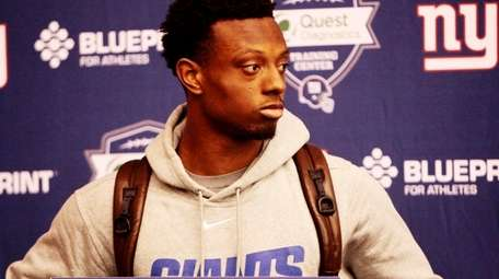 First-round draft pick Eli Apple speaks to the