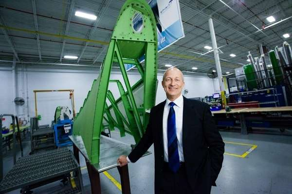 Douglas McCrosson, CEO of CPI Aerostructures, stands on
