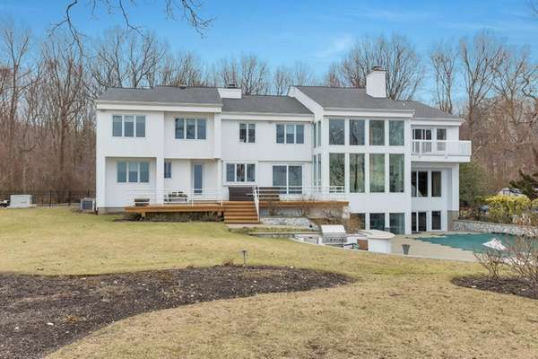 This Lloyd Harbor Colonial includes a 290-gallon fish