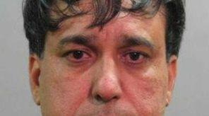 Ravinder Chopra, 50, of New Hyde Park, was