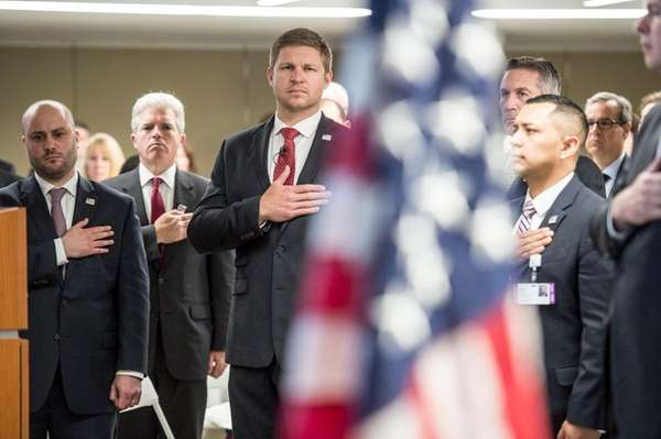 Former Navy SEAL Kevin Lacz, center, joins others