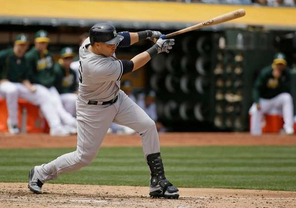 The New York Yankees' Carlos Beltran hits an