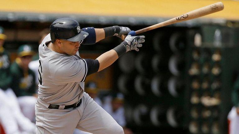 The New York Yankees' Carlos Beltran hits an