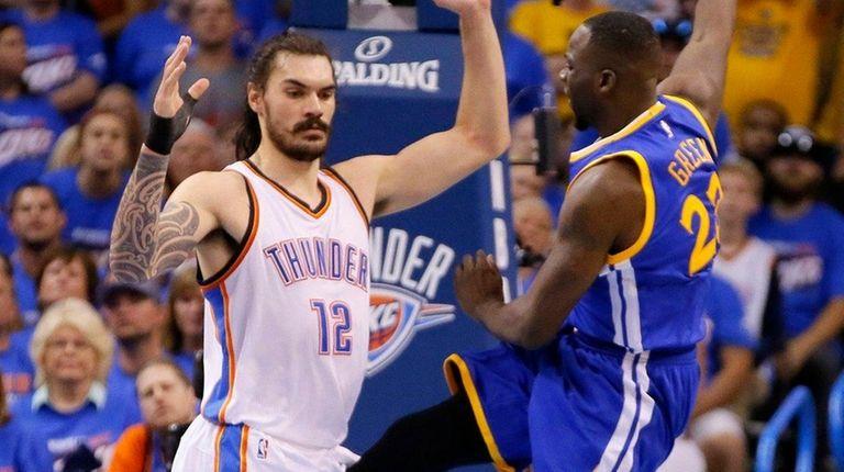Golden State's Draymond Green's kicks Oklahoma City's Steven