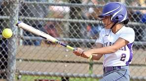 Oyster Bay's Taylor Wilson gets a hit to