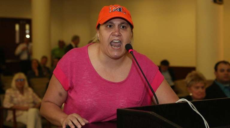 Rosanna Massaro, of Manhasset, calls for the restoration