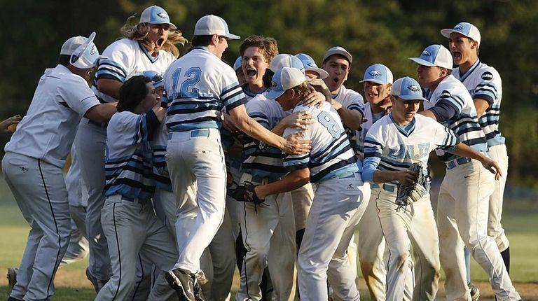 The Rocky Point baseball team surrounds winning pitcher