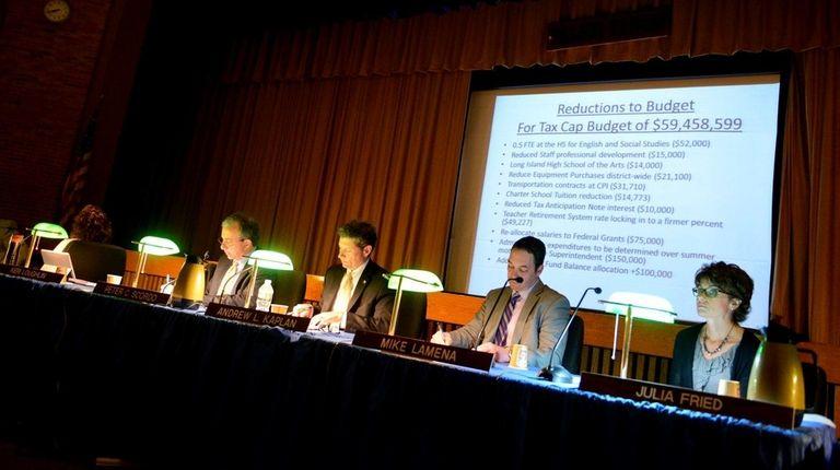 Members of the Elwood school board listen to