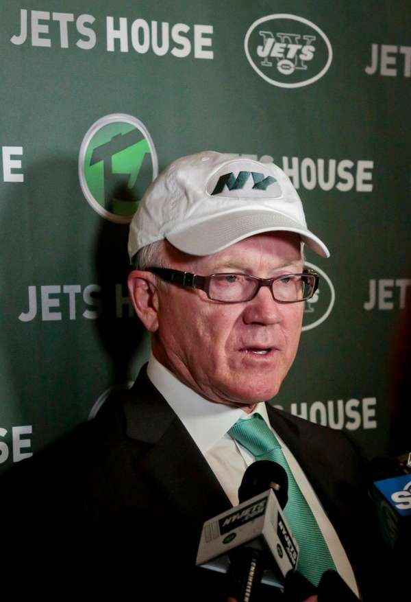 New York Jets owner Woody Johnson holds a