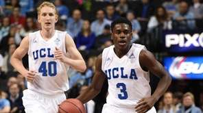 UCLA Bruins guard Aaron Holiday brings the ball