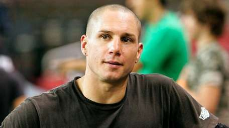 BMX rider Dave Mirra pauses during practice for