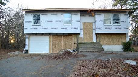 A vacant, foreclosed home is seen in Central